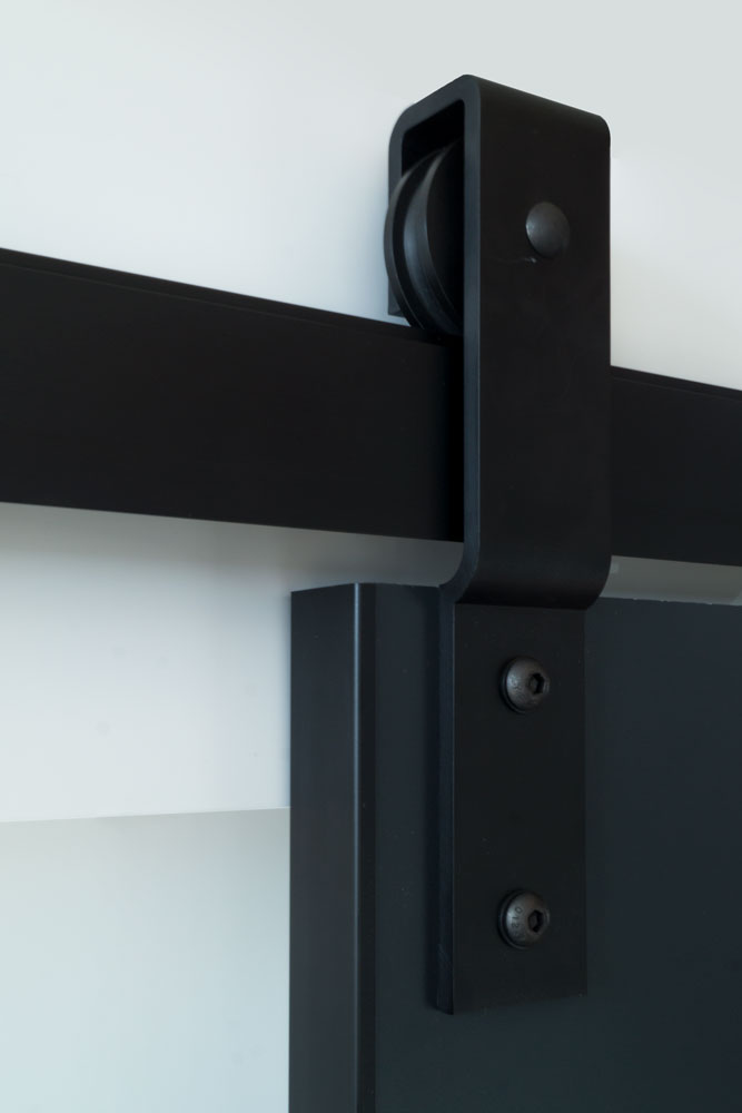 Barn door track with black aluminum door